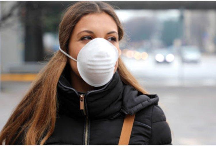 donna con mascherina Sistemi raffrescamento aria